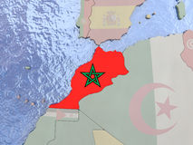 Morocco with flag on globe Royalty Free Stock Photo