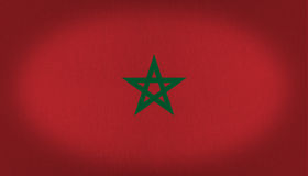 Morocco flag. Green star at the center of this vignette, fabric texture flag, red background with a five points star in crossed lines Stock Photos