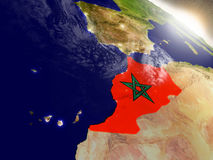 Morocco with flag in rising sun Stock Images