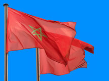 Morocco flags waving in blue sky Royalty Free Stock Photos