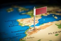 Morocco marked with a flag on the map.  stock images