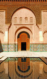 Morocco, Marrakech: Ben Youssef madrasa. Morocco, Marrakesh: the traditional door of the main entrance of the Ben Youssef madrasa or school, pink, white and royalty free stock photography