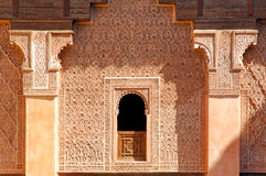Morocco, Marrakech: Ben Youssef madrasa. Morocco, Marrakesh:traditional window at the Ben Youssef madrasa, one of the oldest arabic schools royalty free stock image