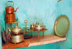 Morocco, Marrakech: traditional wedding crokery. Morocco, Marrakech: traditional wedding crockery, green walls and cooper plates royalty free stock photography