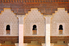 Morocco, Marrakesh: Ben Youssef madrasa. Morocco, Ben Youssef madrasa:three traditional geometrical windows in white and light brown at the arabic school royalty free stock photos