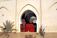 Morocco, Marrakesh: Going to the prayer. Mosque with a traditional old door in red royalty free stock photography