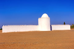 Morocco, Marrakesh: Hamsala. Blue sky, red sand and white mosque stock photography