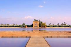 Morocco, Marrakesh: Menara garden. Morocco, Marrakesh: bue sky and blue water at the Menara garden royalty free stock photography