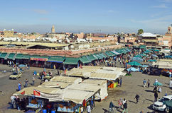 Morocco, Marrakesh. Marrakesh, Morocco - November 23rd 2014: Unidentified people, kiosks, shops and market stalls on Djemaa el-Fna square, a preferred tourist Royalty Free Stock Images