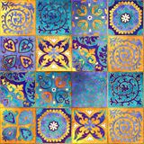 Morocco mosaic design. Abstract ornamental tile background. Seamless patchwork tile in blue, yellow and orange colors. Beautiful vintage pattern in moroccan Stock Photo