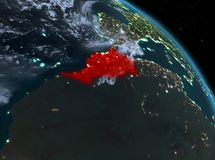 Morocco at night from orbit. Night above Morocco highlighted in red on model of planet Earth in space. 3D illustration. Elements of this image furnished by NASA royalty free stock photography