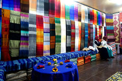 Two Berber women are working in colorful souk fabrics in Morocco Royalty Free Stock Photo