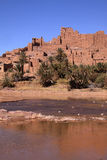 Morocco, Ouarzazate - Tifoultout Kasbah. Morocco Ouarzazate - Tifoultout medieval Kasbah built in adobe viewed from the river bank royalty free stock photos