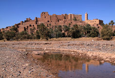 Morocco, Ouarzazate, Tifoultout Kasbah. Morocco Ouarzazate - Tifoultout medieval Kasbah built in adobe -reflecting on the River 'Qued Draa stock photo