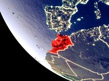 Morocco from space on Earth. Orbit view of Morocco at night with bright city lights. Very detailed plastic planet surface. 3D illustration. Elements of this stock photography