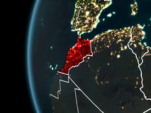 Morocco from space at night. Orbit view of Morocco highlighted in red with visible borderlines and city lights on planet Earth at night. 3D illustration royalty free stock photography