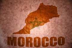 Morocco vintage map. Morocco map on a vintage moroccan flag background royalty free stock photo