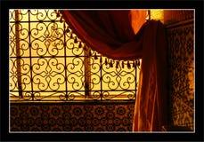 Moroccon interior. Morrocon interior, Marrakesh. Sunset light through a stylish window Royalty Free Stock Photo