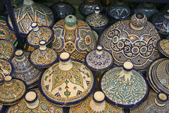 Moroccon Pottery. The pottery, made in Morocco is often very colourful and artistic. These tajines are very beautiful royalty free stock images
