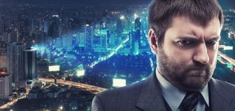 Morose businessman against city Stock Images