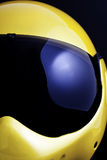 Morotbike Helmet. Shot of a metallic yellow racing helmet with a smoke black visor. There are no trademarks or logos present.  The design is not copyright. The Stock Images