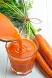Morotfruktsaft för sund drink royaltyfri foto