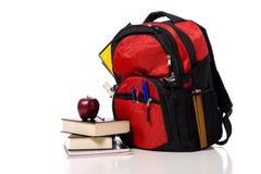 Morral rojo de la escuela con los libros Imagen de archivo libre de regalías