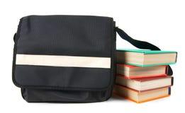 Morral y libros de la escuela Imágenes de archivo libres de regalías