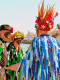 Morris dancers in conversation. Royalty Free Stock Photo