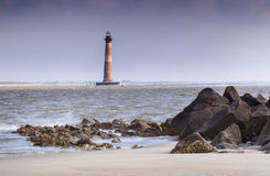Morris Island Lighthouse Charleston South Carolina. Morris Island Lighthouse from the rocky shoreline of Folly Beach near Charleston, South Carolina Stock Photography