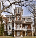 Morrison Second Empire House. This is a Winter picture of a Four story mansion in Morrison, Illinois in Whiteside County.  This brick mansion built in the 19th Stock Photos
