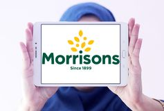 Morrisons Supermarkets chain logo. Logo of Morrisons Supermarkets chain on samsung tablet holded by arab muslim woman.  Morrisons, is the fourth largest chain of Royalty Free Stock Photography