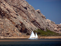 Morro Bay. Sail boat parked next to the rock at Morro Bay royalty free stock photography