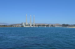 Morro Bay, California with Desalination Plant. Between blue sea and blue sky Royalty Free Stock Images