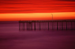 Morro Bay pier at sunset, CA Stock Image