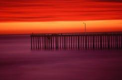 Morro Bay pier at sunset, CA Stock Image