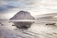 Morro bay rock and beach in the sunset evening royalty free stock images