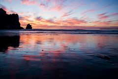 Morro Bay Sunset. The reflection of the clouds on the beach in Morro Bay at sunset Stock Photography