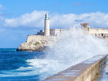 The Morro Castle in Havana with a stormy ocean. And big waves crashing on the seawall Royalty Free Stock Photos