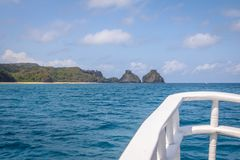 Morro Dois Irmaos view from a Boat in the Inner Sea - Fernando de Noronha, Pernambuco, Brazil Royalty Free Stock Image