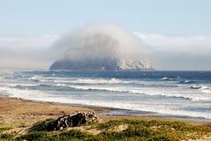 Morro Rock. In morro bay california on a foggy sunny day royalty free stock photo
