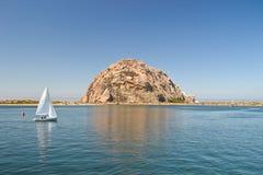 Morro Rock and sailing boat. Morro Rock and boat. Morro Bay near San Luis Obispo, CA. USA stock photos