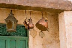 Morrocan Doorway. Old copper pots hanging in a Moroccan doorway Stock Images