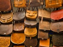 Morrocan leather bags on a bazar. Many beautiful leather bags on a moroccane bazar in Essaouira Stock Photo