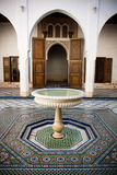 Morrocan mosaic floor and wooden door Stock Photo