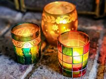 Morrocan styled colour jars used as tea lights royalty free stock photo