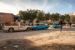 Morrocan taxi stand place in a village. Unpaved village  road with taxi Royalty Free Stock Photos