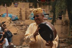 Morrocan villagaer playing drum. This was shot at morroco in agadir he was playing the instrument i captured it at the right time this image will be useful for Royalty Free Stock Photo