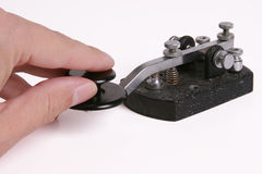 Morse Code Key with hand. On knob Royalty Free Stock Image