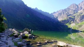Morskie oko Lake in the Tatra Mountains at sunrise, Poland stock footage